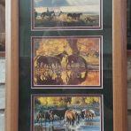 Four artist prints framed as a set